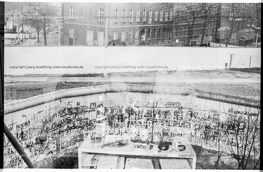 West Germany, Berlin, the wall in year 1988, double exposure with table