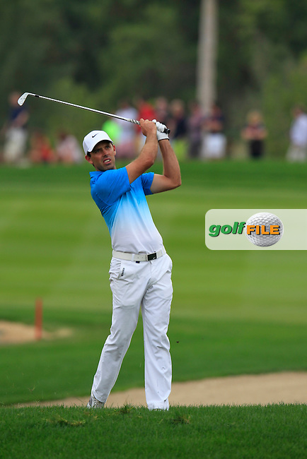 Charl Schwartzel (RSA) plays from the rough on the 18th hole during Sunday's Final Round of the Abu Dhabi HSBC Golf Championship 2015 held at the Abu Dhabi Golf Course, United Arab Emirates. 18th January 2015.<br /> Picture: Eoin Clarke www.golffile.ie
