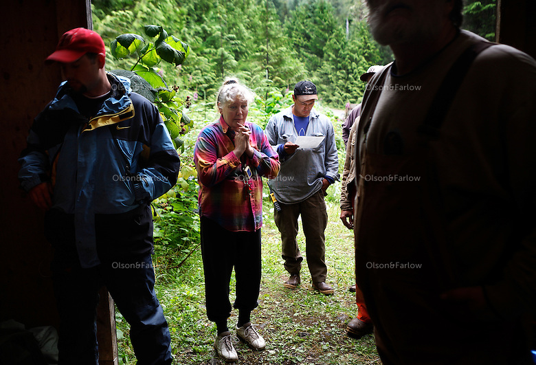 People gather for a rescue mission called to look for a man who disappeared on Kosciusko Island a week ago. 30 searchers from Edna Bay, Thorne Bay and Klowak gathered for a briefing before going to remote part of the island where a print was found the day before in the muskeg bog.  Armed for bear country, they loaded up into vehicles after hearing instructions.