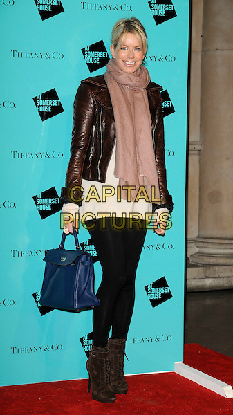 CAROLINE STANSBURY.Tiffany & Co. presents Skate at Somerset House, VIP Opening of the 10th Annual Somerset House Ice Rink, London, England. .November 16th, 2009 .full length black leggings boots brown leather jacket pink scarf stansbury blue bag purse .CAP/CAN.©Can Nguyen/Capital Pictures.