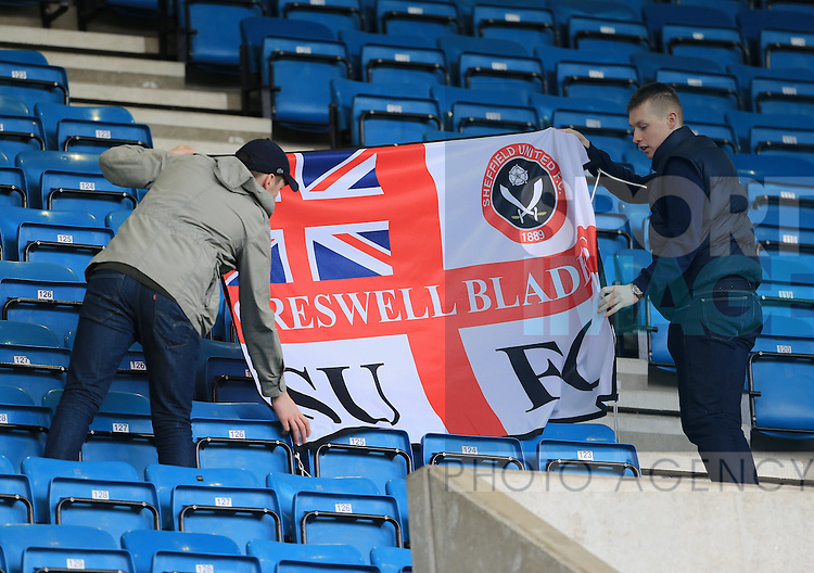 Two Sheffield United fans put up their flag during the League One match at The Den.  Photo credit should read: David Klein/Sportimage