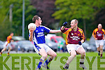 Charlie Kerins' David Rusk side steps William Dennehy of Duagh in the Division 7 Junior Final held last Friday evening in Castleisland.