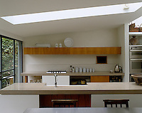 A central light well, positioned over the main work surface and mirroring its size and shape allows light to pour into the kitchen