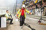 Solna 2014-08-13 Fotboll Allsvenskan AIK - Djurg&aring;rdens IF :  <br /> Brandpersonal personal p&aring; Friends Arena b&auml;r undan utbrunna bengaliska eldar nedanf&ouml;r AIK:s supportrar under matchen<br /> (Foto: Kenta J&ouml;nsson) Nyckelord:  AIK Gnaget Friends Arena Allsvenskan Derby Djurg&aring;rden DIF bengaler bengaliska eldar r&ouml;k tifo pyroteknik pyro brand eld