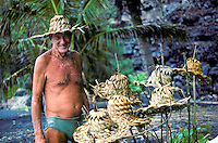 Pappy showing off his handwoven hats at Kehena Beach on the Big Island of Hawaii.