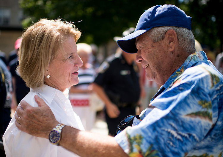 "UNITED STATES - JULY 4: U.S. Senate candidate Rep. Shelley Moore-Capito, R-W.Va., speaks with residents before the start of the Ripley 4th of July Parade in Ripley, W. Va., on July 4, 2014. The parade is billed as ""the USA's largest small town Independence Day Celebration. (Photo By Bill Clark/CQ Roll Call)"