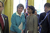 White House Communications Director Karen Hughes and National Security Advisor Condoleeza Rice speak in the Oval Office in the White House in Washington, DC during the photo op with President Hosni Mubarak of Egypt on April 2, 2001.<br /> Credit: Ron Sachs / CNP