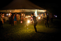 West Coxsackie, NY - June 7, 2014: Burning sparklers at the wedding of Jessica Lawrence and Brian Quinn. <br /> <br /> CREDIT: Clay Williams.<br /> <br /> &copy; Clay Williams / claywilliamsphoto.com