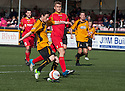 Alloa's Kevin Cawley scores their fourth goal to secure second place.