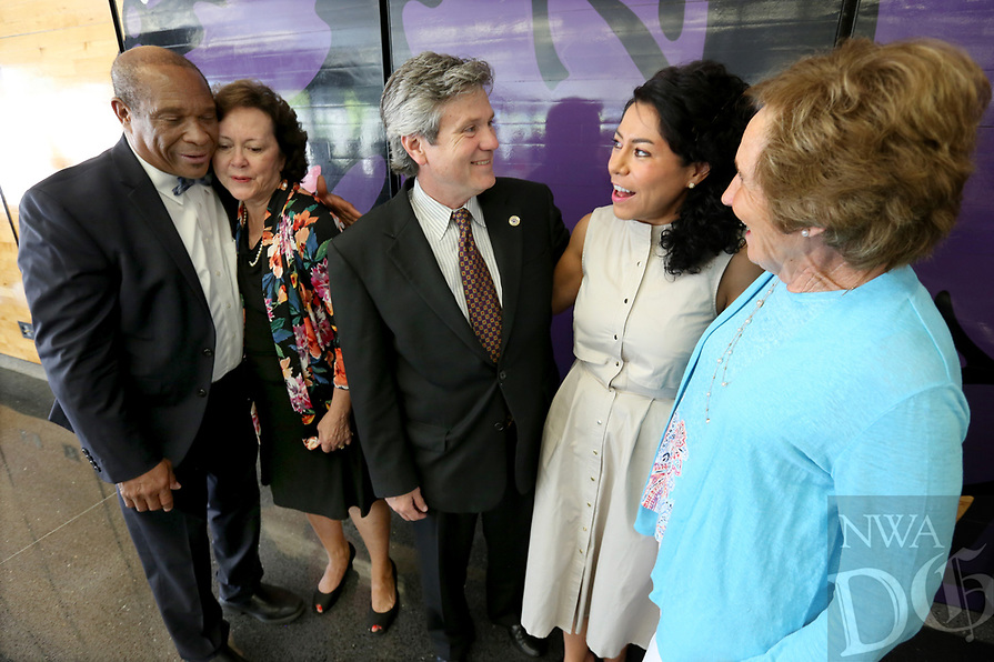 NWA Democrat-Gazette/DAVID GOTTSCHALK John L. Colbert (from left), superintendent of Fayetteville Public Schools, hugs Tuesday, August 5, 2019, Lolly Greenwood, Fayetteville Schools Hall of Honor 2019 honorees, as they stand with Conrad Odom and Mireya Reith, both 2019 honorees, and Carolyn Schmitt, the daughter of 2019 honoree Carmen Lierly during the announcement of the honorees at the 2019 Hall of Honor Luncheon at Fayetteville High School. The hall commemorates educators, alumni and friends that have demonstrated fidelity, honor and service to the Fayetteville Public Schools and community.