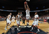 Virginia guard Justin Anderson (1) grabs a rebound during an NCAA basketball game Saturday Feb, 24, 2014 in Charlottesville, VA. Virginia defeated Miami 65-40.