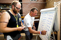 07 AUG 2010 - LICHFIELD, GBR - Dan Earthquake and Paul Gallagher update the leaders board during the Triple Iron race swim at the Enduroman Ultra Triathlon Championships .(PHOTO (C) NIGEL FARROW)