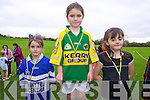 Taylor White , Mary Ellen McCarthy and Caoimhe O'Donoghue who were the top three under the 1st class girls category at the Kenmare Athletics Club running competition last week.
