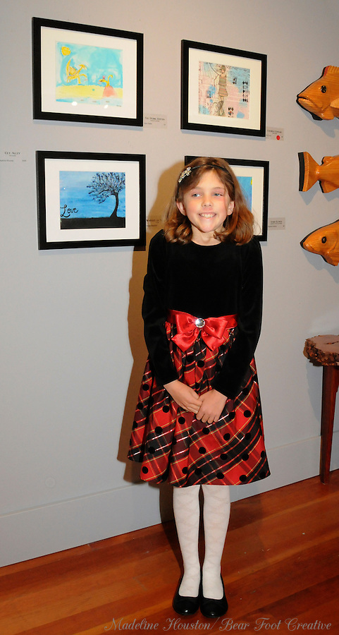 """Artist Anna Gunter with her watercolor and pastel """"The Fishing Dritten"""" at Rectangle Gallery's Gala Opening for Youth Art Exhibition during Centralia, Washington's Third Thursday on October 20, 2016."""