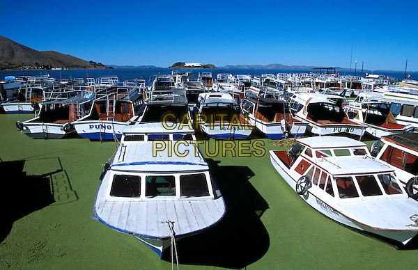 Boats moored in Puno Harbour, on Lake Titicaca, Puno, Peru