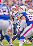 21 September 2014: San Diego Chargers quarterback Philip Rivers looks for an open receiver during a game against the Buffalo Bills at Ralph Wilson Stadium in Orchard Park, NY. The Chargers defeated the Bills 22-10 in AFC play. Mandatory Credit: Ed Wolfstein Photo *** RAW (NEF) Image File Available ***
