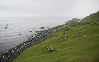peloton racing along the Irish Sea<br /> <br /> Giro d'Italia 2014<br /> stage 2: Belfast-Belfast <br /> 219km