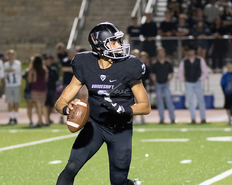 Vandegrift Vipers senior quarterback Alex Fernandes (3) scrambles in the backfield during the first half of a high school football game between the Vandegrift Vipers and the Leander Lions at Monroe Stadium in Austin, Texas, on October 7, 2016.
