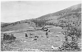 An early view, looking north by northwest, of Marshall Pass with D&amp;RG snowshed installed, but before MoW facilities and water tank were erected on the eastbound curve.<br /> D&amp;RGW  Marshall Pass, CO  Taken by Cross, Whitman