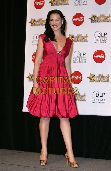 KATHERINE HEIGL.SHOWEST Final Night Talent Awards at the Paris Resort Hotel and Casino,  Las Vegas, Nevada , USA,.18th March 2010..full length red dress sleeveless gold platform christian louboutin shoes heels cork open peep toe slingbacks low cut pink brooch smiling .CAP/ADM/MJT.© MJT/AdMedia/Capital Pictures.