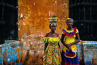 Afro-Colombian girls, dressed in the traditional 'palenquera' costume, pose for a picture in front of a colonial house in walled city of Cartagena, Colombia, 12 December 2017. With the peace agreement, ending a 52-year civil conflict and promising political stability, together with rapid economic growth and unexploited tourism potential, Colombia has truly become a holiday destination. Cartagena, a UNESCO World Heritage site on the tropical Caribbean coast, plays the primary role in Colombia's tourism renaissance. The historic sites from the Spanish colonial times are being restored, private investments are visible throughout the city and an increased number of local people benefit from the boom of the travel related services.