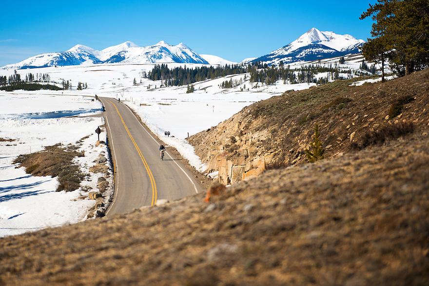 Cyclists cross Swan Lake Flat in Yellowstone National Park during the spring biking season.