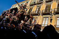 The large throne, with the Paso scene featuring Jesus Christ crucifixion on the top, is carried during the Holy Week fiesta in Malaga, Spain, 5 April 2007.