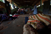 """A child,displaced by recent bombings in his town, sleeps on a school's floor where she is hosted together with other 100 families in  Trincomalee, in Eastern Sri Lanka on Sunday October 08 2006..hundreds of families from Mutur had to abbandone their homes when caught in the cross fire between LTTE forces and government  forces in early August..The Sri Lanka civil war is an ongoing conf, The Sri Lanka civil was is an ongoing conflict on the island nation of Sri Lanka Since the 1983 """"Black July""""  pogrom there has been on and off civil war, mostly between the government and the Liberation Tigers of Tamil Eelam, or the LTTE, who want to create an independent state of Tamil Eelam in the north east of the island. It is estimated that the war has left 65000 people dead since 1983 and caused great harm to the population and economy of the country. A cease fire was declared in 2001, but hostilities renewed in late 2005. Following escalation of violence         in July 2006, a senior rebel leader declared the ceasefire null and void, although both sides later reaffirmed their commitment to the ceasefire agreement. Hundreds of people, including military personnel, rebels, and Tamil, Sinhalese and muslim civilians have been killed in fighting this year. Thousands of civilians have been displaced, many coming from areas already stroke by the dec 2004 Tsunami.."""