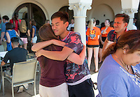 Ian McPherson '19, hugs his mother, Arleen McPherson, goodbye during the Ice Cream Social and Goodbyes in the Samuelson Alumni Center during Orientation, Aug. 23, 2015. His father, Ed, is on the right.