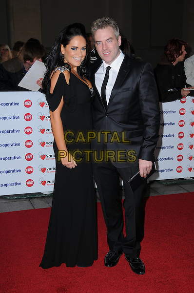 AMEERA DE LA ROSA & DONAL MACINTYRE .The Co-operative Variety Club Showbiz Awards, Grosvenor House Hotel, Park Lane, London, England, UK, .14th November 2010. .full length black long maxi dress suit tie couple married husband wife mcintyre .CAP/CAS.©Bob Cass/Capital Pictures.
