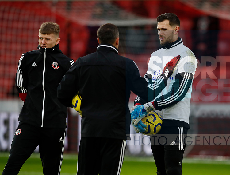 Jake Eastwood and Michael Verrips of Sheffield Utd listen to coach Darren Ward during the Premier League match at Bramall Lane, Sheffield. Picture date: 9th February 2020. Picture credit should read: Simon Bellis/Sportimage