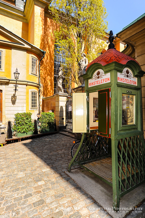 Sweden, Stockholm. Storkyrkan is the oldest church in Gamla Stan. Old Telephone boot outside the church.