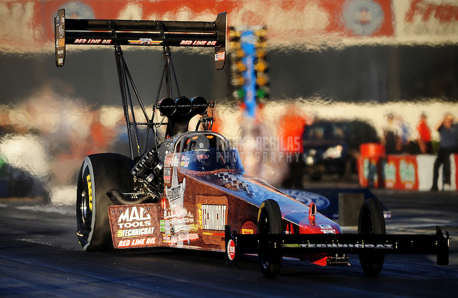 Nov 11, 2010; Pomona, CA, USA; NHRA top fuel dragster driver Doug Kalitta during qualifying for the Auto Club Finals at Auto Club Raceway at Pomona. Mandatory Credit: Mark J. Rebilas-