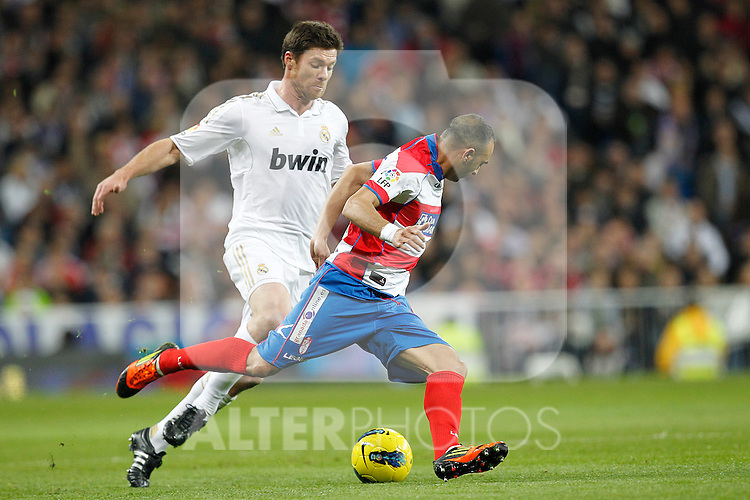 Real Madrid's Xabi Alonso and Granada's CF Carlos Martins during Spanish  League match on January 7th, 2012..Photo: Cesar Cebolla / ALFAQUI
