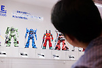 A visitor looks at a Gundam action figures on display at the 56th All Japan Model & Hobby Show in Tokyo Big Sight on September 25, 2016. The exhibition introduced hobby goods such as plastic models, action figures, drones, and airsoft guns. (Photo by Rodrigo Reyes Marin/AFLO)