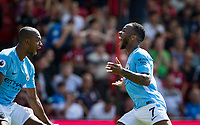 Raheem Sterling of Manchester City celebrates scoring an injury time winning goal with Fernandinho of Manchester City during the Premier League match between Bournemouth and Manchester City at the Goldsands Stadium, Bournemouth, England on 26 August 2017. Photo by Andy Rowland.