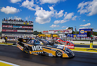 Aug 15, 2014; Brainerd, MN, USA; NHRA funny car driver Tony Pedregon (near lane) races alongside Chad Head during qualifying for the Lucas Oil Nationals at Brainerd International Raceway. Mandatory Credit: Mark J. Rebilas-