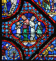 Men talking with giants, from the causes of the flood, from the Life of Noah stained glass window, 13th century, in the nave of Chartres cathedral, Eure-et-Loir, France. Chartres cathedral was built 1194-1250 and is a fine example of Gothic architecture. Most of its windows date from 1205-40 although a few earlier 12th century examples are also intact. It was declared a UNESCO World Heritage Site in 1979. Picture by Manuel Cohen