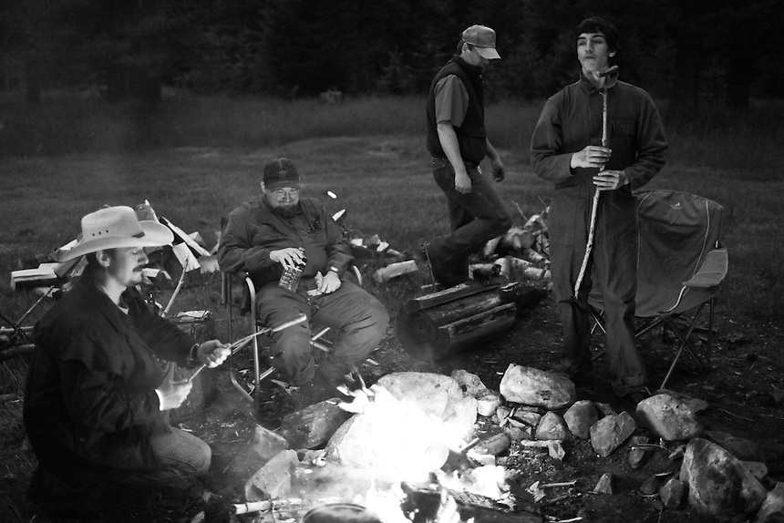The Idaho Light Foot Militia gather around the campfire prior to a weekend-long training exercise on public lands near Priest Lake, Idaho.