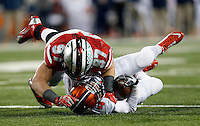 Ohio State Buckeyes defensive lineman Joey Bosa (97) sacks Illinois Fighting Illini quarterback Reilly O'Toole (4) in the third quarter of the NCAA football game at Ohio Stadium on Saturday, November 1, 2014. (Columbus Dispatch photo by Jonathan Quilter)