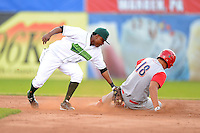 Jamestown Jammers second baseman Jodaneli Carvajal #12 applies the tag to Dylan Cozens #18 during a game against the Williamsport Crosscutters on June 20, 2013 at Russell Diethrick Park in Jamestown, New York.  Jamestown defeated Williamsport 12-6.  (Mike Janes/Four Seam Images)