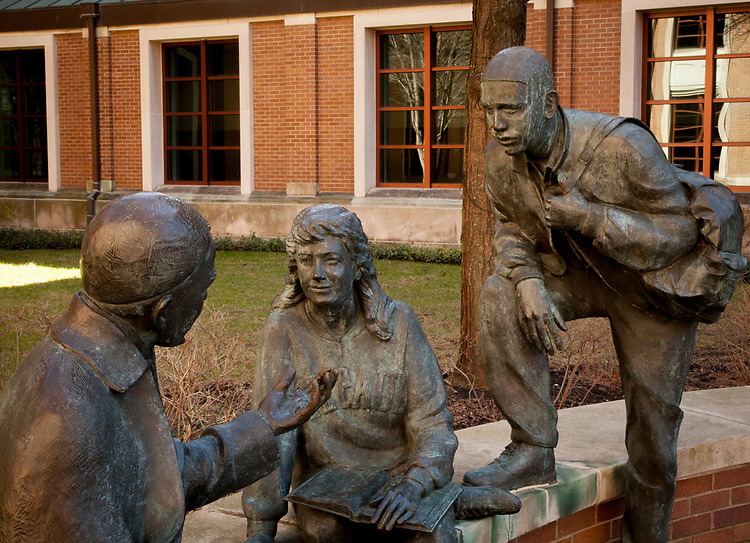 The Saint Vincent Statue, depicting Saint Vincent talking with two students, located east of the quad, sits awaiting spring Tuesday, March 7, 2017. (DePaul University/Arielle Toub)