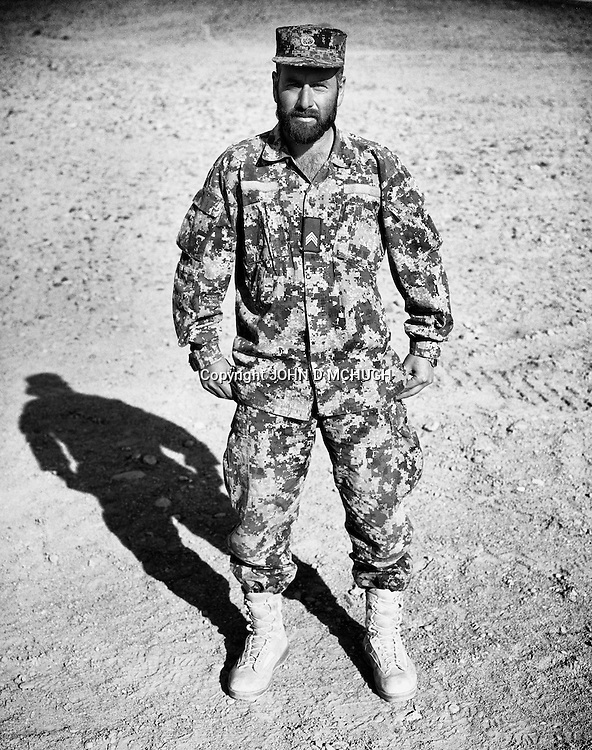 Sergeant Khodai Doost, of the Afghan National Army, is seen at the Regional Military Training Centre in helmand, 12 November 2012. This portrait was shot on a 5x4 Linhof Technika IV, circa 1959, and a Voigtlander Braunschweig Heliar 15cm lens, circa 1922. (John D McHugh)