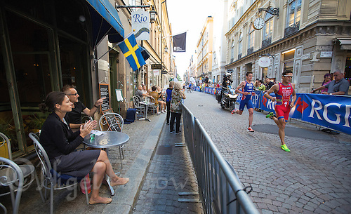 25 AUG 2013 - STOCKHOLM, SWE - Javier Gomez (ESP) (right) of Spain leads Jonathan  Brownlee (GBR) of Great Britain during the run through the streets of Gamla Stan, the old part of Stockholm, Sweden, during the elite men's ITU 2013 World Triathlon Series round (PHOTO COPYRIGHT © 2013 NIGEL FARROW, ALL RIGHTS RESERVED)