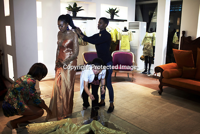 LAGOS, NIGERIA MAY 24: Nigerian fashion designer Deola Sagoe prepares for a photo shoot in her flagship store on May 24, 2013 on Victoria Island in Lagos, Nigeria. Deola is one of the best and celebrated local designers and she has shown her designs around Africa and the world. (Photo by: Per-Anders Pettersson)