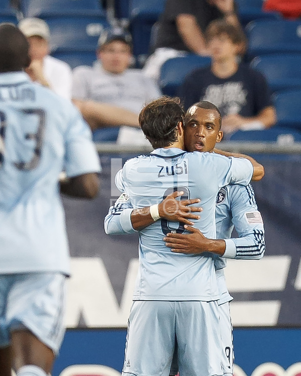 Sporting Kansas City forward Teal Bunbury (9) celebrates his goal with teammates. In a Major League Soccer (MLS) match, Sporting Kansas City defeated the New England Revolution, 1-0, at Gillette Stadium on August 4, 2012.