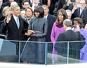 United States President Barack Obama takes the oath of office during the public swearing-in ceremony at the U.S. Capitol in Washington, D.C. on Monday, January 21, 2013.  From left to right: President Obama, first lady Michelle Obama, Malia Obama, U.S. Chief Justice John Roberts, and Sasha Obama..Credit: Ron Sachs / CNP.(RESTRICTION: NO New York or New Jersey Newspapers or newspapers within a 75 mile radius of New York City)