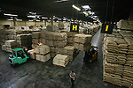 EDISON, NJ - MAY 11, 2006:  Workers move coffee inside an RPM warehouse on May 11, 2006 in Edison, NJ.  The NYBOT sanctioned warehouse can hold approximately 65 million pounds of coffee, roughly 450,000 bags.  According to the Green Coffee Association's March '06 report, RPM has about 50% of the green coffee market in the United States.  (Photo by Michael Nagle)