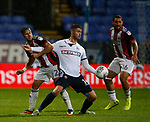 George Baldock of Sheffield Utd challenges Gary Madine of Bolton Wanderers during the Championship match at the Macron Stadium, Bolton. Picture date 12th September 2017. Picture credit should read: Simon Bellis/Sportimage