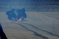 Feb. 27, 2011; Pomona, CA, USA; NHRA funny car driver Bob Bode slides to a stop after a fire during the Winternationals at Auto Club Raceway at Pomona. Mandatory Credit: Mark J. Rebilas-.